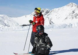 A young skier is learning to ski with the help of his ski instructor from the ski school Red Carpet Champéry during his Private Ski Lessons for Kids (3-9 years) - All Levels.