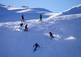 Kids doing a Kids Ski Lessons (7-16 y.) for All Levels with ABC Snowsport School in Arosa.