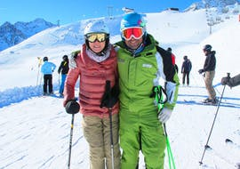 A ski instructor smiling at the camera with a customer of the Private Ski Lessons for Kids & Adults - All Levels organized by the ski school Ski- and Bike School Ötztal Sölden in the ski area Ötztal in Sölden.