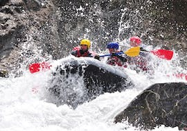 Friends are caught up in heavy rapids during their Adventurous Rafting Combo on the Ubaye River with Anaconda Rafting.