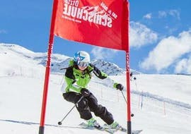"""A young skier is mastering the slopes in the ski area of Ötztal in Sölden during the Private Ski Lessons """"Race Training"""" for Kids - All Levels organized by the ski school Ski- and Bike School Ötztal Sölden."""