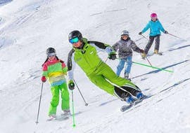 """A ski instructor of the ski school Ski- and Bike School Ötztal Sölden is teaching the basics of skiing to a small group of young skiers during the Kids Ski Lessons """"All-in-One"""" (11-14 years) - All Levels in the ski area of Ötztal in Sölden."""
