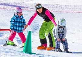 """A ski instructor is teaching the basics of sking to two young skiers during the Kids Ski Lessons """"All-in-One"""" (3-10 years) - All Levels organized by the ski school Ski- and Bike School Ötztal Sölden in the ski area Ötztal in Sölden."""