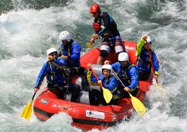 A group of friends have a good time while taking part to the Rafting Fun on Sesia river provided by the Centro Canoa e Rafting Monrosa.