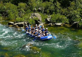 """A rafting group paddling down the waters of beautiful Cetina River on their Rafting Tour """"Classic"""" together with a certified guide from Croatia Rafting."""