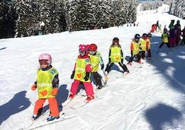 Cours de ski Enfants (4-15 ans) - Après-midi avec ESI Grand Massif