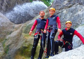 A father and his two sons are posing for a photo in the canyon during their Adventure Canyoning in the Strubklamm with Torrent Outdoor Experience.