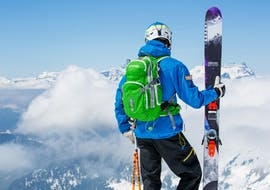 Skiers hold their skis while enjoying the view of the countryside during the Private Ski Lessons for Adults - Chamonix - All Levels with the ski school Freedom Snowsports.