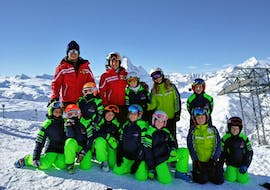 A group of kids having fun on the snow with Cortina Valentina.