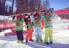 A group of smiling kids after the final race of their Kids Ski Lessons (4-6 years) - First Timer with the ski school Scuola di Sci e Snowboard Cristallo Cortina.