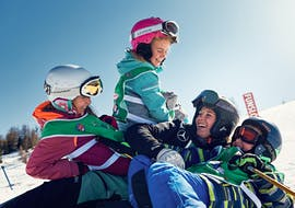 Kid having fun in La Villa during one of the Kids Ski Lessons (4-12 y.) for All Levels.