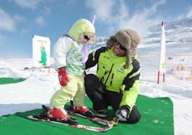 "A Kid is following Kids Ski Lessons ""Baby Club"" (2½-4 y.) with EasySki Alpe d'Huez."