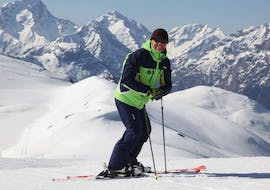 A man is following Private Ski Lessons for Adults of All Levels - Holidays with our partner EasySki Alpe d'Huez.