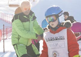 Kid with ski instructor in Bormio during one of the Kids Ski Lessons (6-12 y.) for All Levels - Half Day