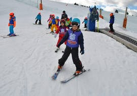 A group of kids have fun skiing during a ski lesson in Baqueira with Escuela Ski Baqueira.