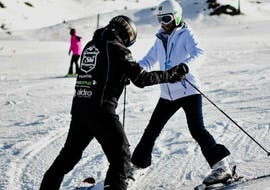 A student learns how to ski during a ski lesson for adults in Baqueira with Escuela Ski Baqueira.