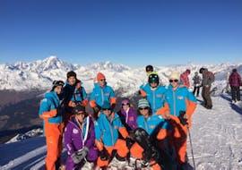 Des adultes participent à des Cours de snowboard (dès 10 ans) - Arc 1950 avec Evolution 2 Spirit - Arc 1950 & Villaroger.