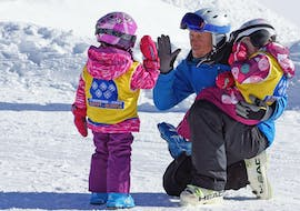 Two little girls are participating in some kids ski lessons for all levels with ski school Neustift Olympia at the Stubai glacier.