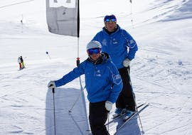 2 people over 50 years are taking part in ski Lessons for people in their golden age with ski school Neustift Olympia at Stubai glacier.