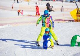 A kid is taking Private Ski Lessons for Kids - High Season - Arc 1950 with Evolution 2 Spirit - Arc 1950 & Villaroger.