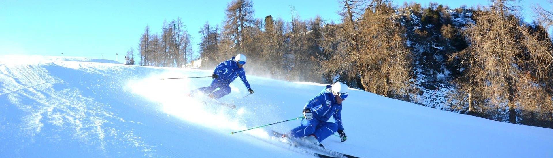 Ski Lessons for Adults - All Levels of the Folgarida Dimaro Ski School are taking place, participants are training on the slopes of Val di Sole.