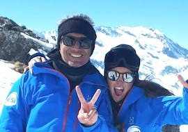 A skier is taking break with his ski instructor from 333 Ski School during the Private Ski Lessons for Adults - Val d'Isère.