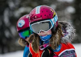 Two young skiers are smiling at the camera during their Private Ski Lessons for Kids - Holiday - All Ages with the ski school ESI Font Romeu.