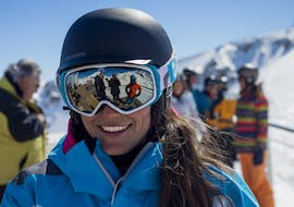 A skier is smiling to the camera during her Private Ski Lessons for Adults - Low Season - All Levels with the ski school ESI Font Romeu.